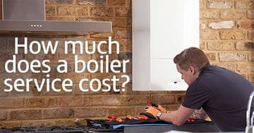 How much does a boiler service cost? Picture of a tradesperson working on a boiler