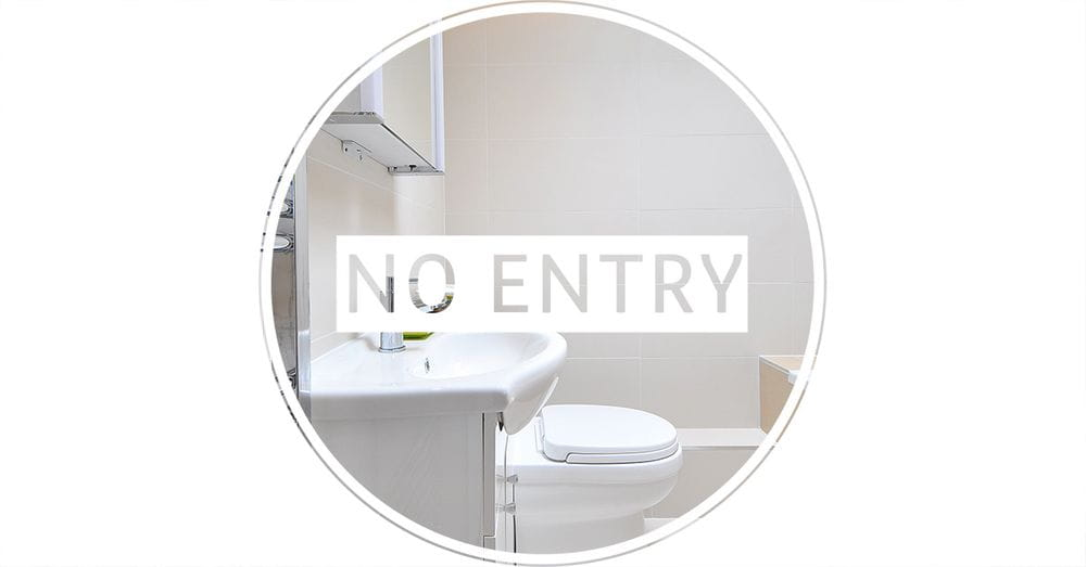 Image of a bathroom with a no entry sign