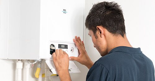 Man investigating boiler error
