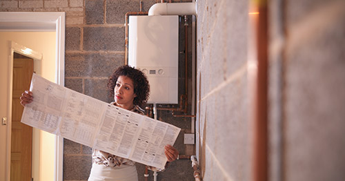 Woman holding folded out boiler instructions