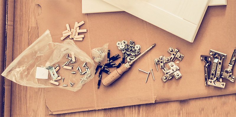 An image of screws and parts from flatpack furniture
