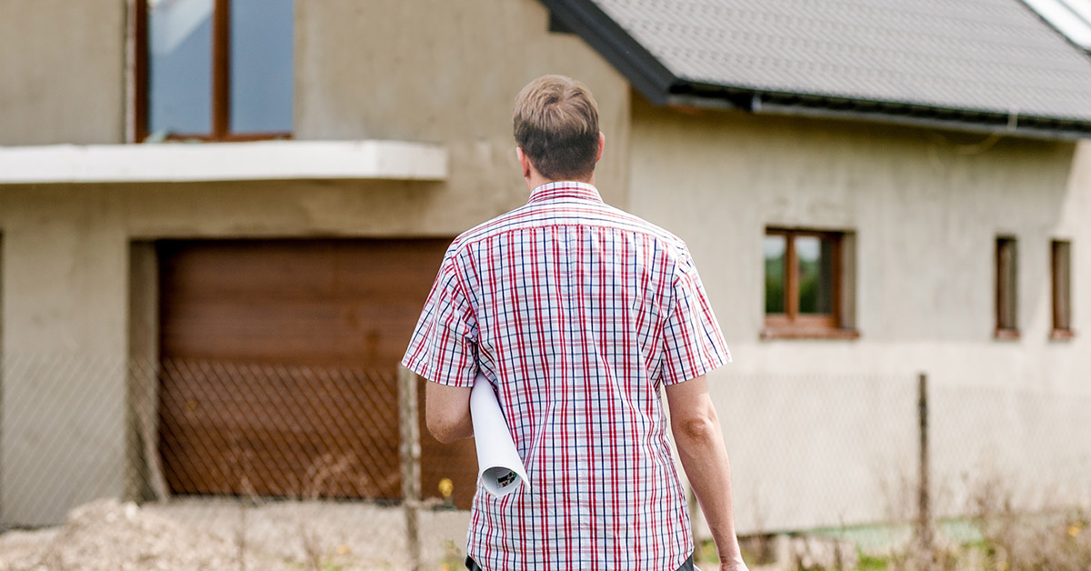 Picture of a man standing in front of a home