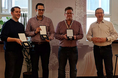 Centrica Award winners Rob Anderson, Mat Moakes and Ben Goode with Centrica executive Charles Cameron